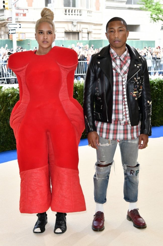 Pharrell Williams and wife Helen Lasichanh both casually draped in Comme des Garçons
