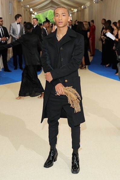 Jaden Smith carrying his hair as an accessorie to compliment his Louis Vuitton suit.